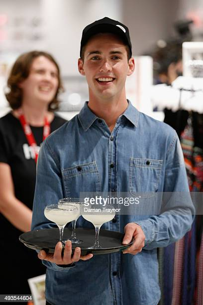 A waiter presents drinks to guests at the launch of the first Australian MRP store at Melbourne Central on October 21 2015 in Melbourne Australia