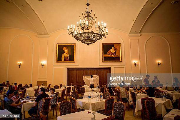 A waiter replaces a tablecloth at a dinner buffet dining hall in an all inclusive Russian themed resort on July 11 2016 in Antalya Turkey Russian...