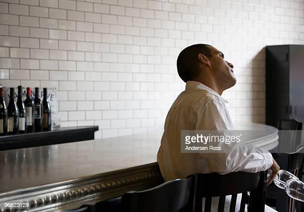 Waiter resting in restaurant bar