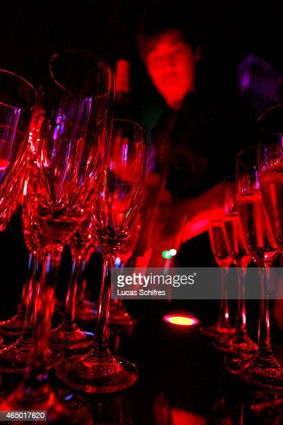 A waiter serves Champagne in Bar Rouge on May 9 2008 in Shanghai China