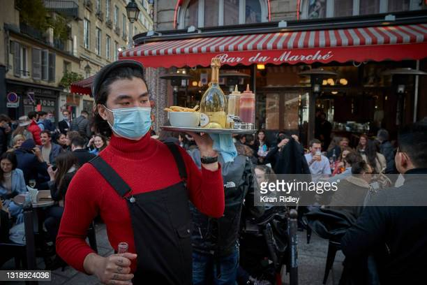 Waiter serves customers on the terrace at Bar du Marche in Paris' 6th Arrondissement as cafes and restaurants across France re-open for the first...