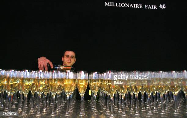 Waiter serves drinks at the Millionaire Fair 2007 at Crocus Expo November 22, 2007 in Moscow, Russia. The Millionaire Fair, the world's largest...