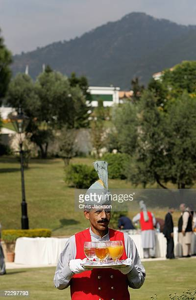 A waiter serves drinks at the Prime Minister's House on day two of a week long Royal tour of the country on October 30 2006 in Islamabad Pakistan