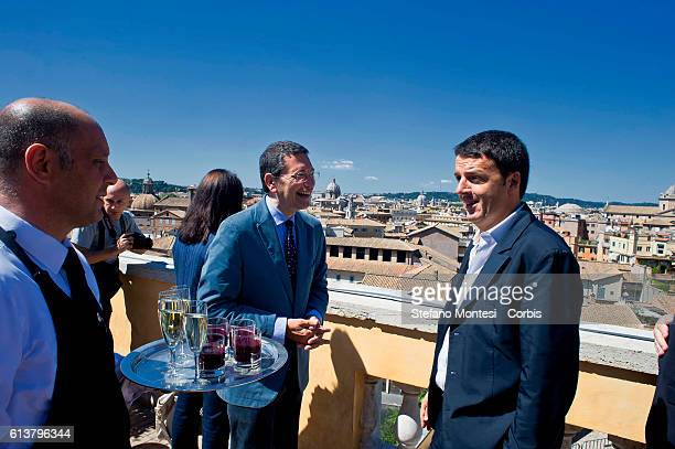 A waiter serves drinks to the terrace Cafferelli during the meeting of the Ignazio Marino mayor di Rome and Matteo Renzi mayor Florence a visit to...