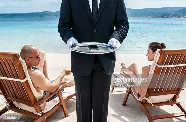 waiter service on the beach - premium access stock pictures, royalty-free photos & images