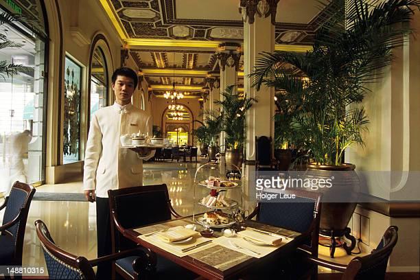 waiter serving afternoon tea at peninsula hotel, tsim sha shui. - peninsula stock pictures, royalty-free photos & images