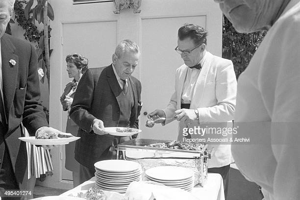 A waiter serving American director William Wyler at a breakfast in Hollywood Hollywood 22nd June 1964