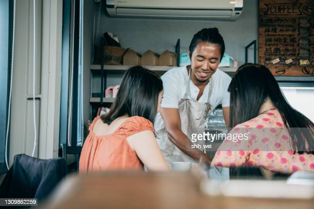 waiter serving at table - taiwan stock pictures, royalty-free photos & images