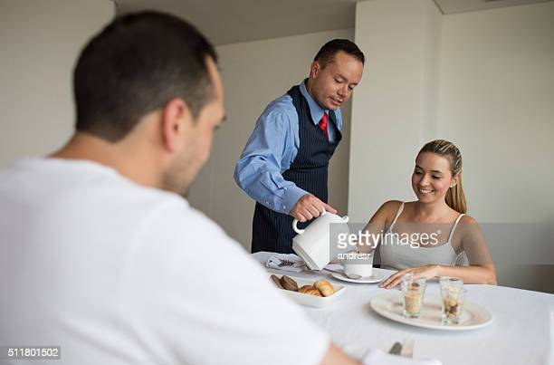 Waiter serving breakfast at a hotel