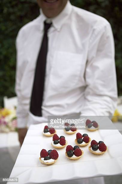 Waiter serving canapes