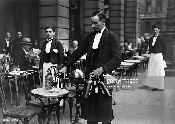 Waiter serving drinks during the heatwave in 1928 in Paris France