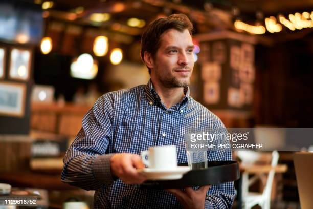 waiter serving drinks in a coffee shop - serving size stock pictures, royalty-free photos & images