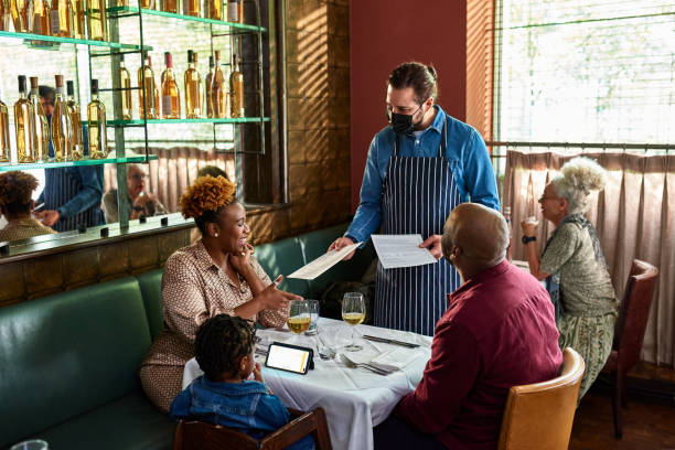 waiter serving family in restaurant picture id1289925636?k=20&m=1289925636&s=612x612&w=0&h=v3qjt YjPJ