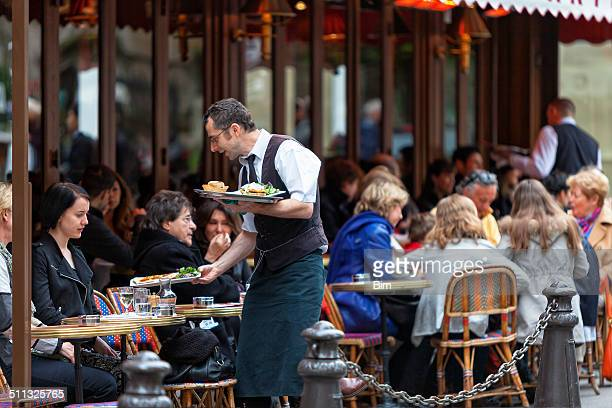 waiter serving food, cafe le bonaparte, saint germain, paris, france - french cafe stock photos and pictures