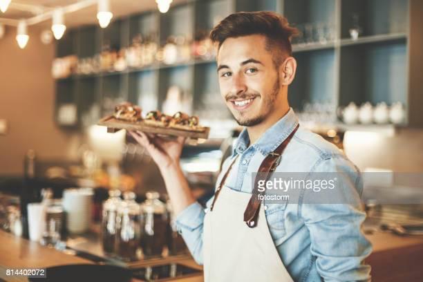 Waiter serving healthy snack