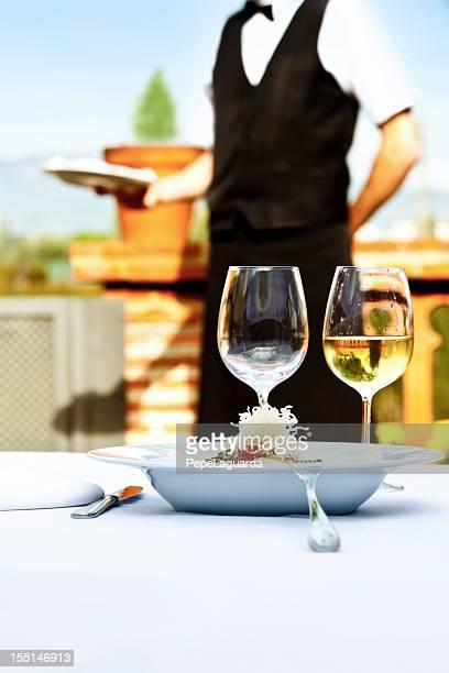Waiter serving in a restaurant
