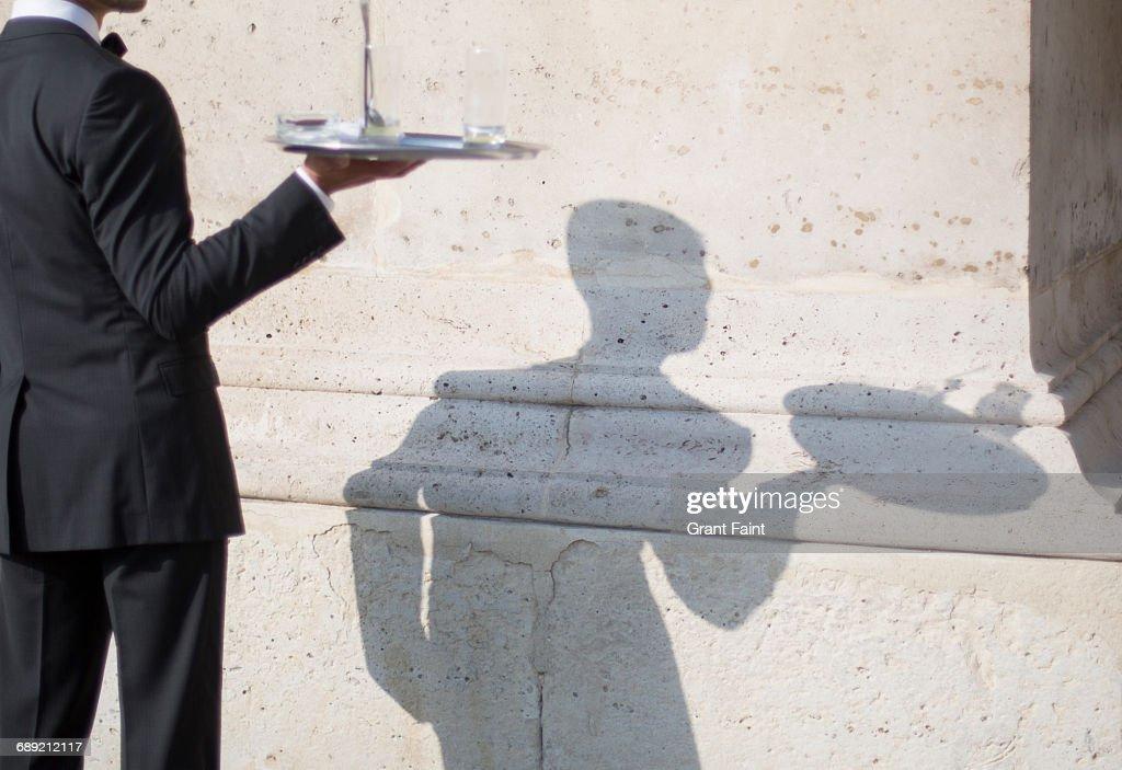 Waiter serving. : Stock Photo