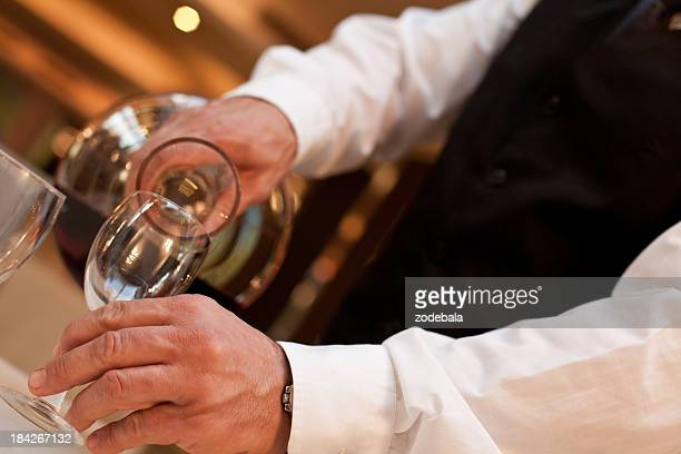 Waiter Serving Red Wine at Restaurant