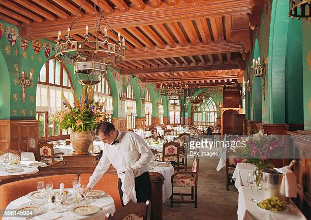 waiter setting tables at hotel restaurant - carcassonne stock pictures, royalty-free photos & images