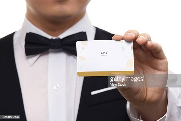 Waiter showing VIP card
