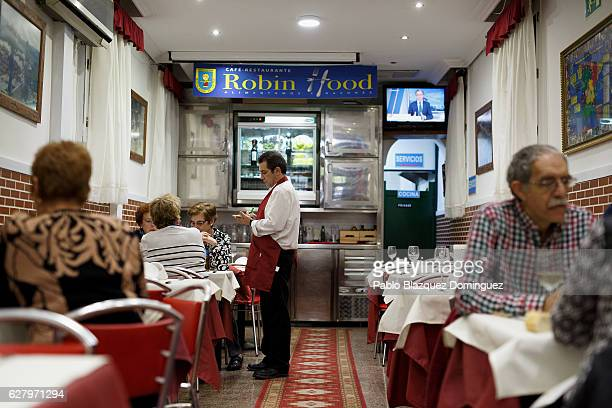 A waiter takes orders for lunch from paying clients during the day at Robin Hood restaurant on December 5 2016 in Madrid Spain Association Messengers...