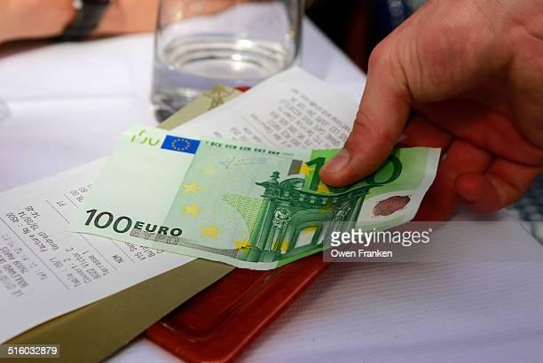 Waiter taking money, Paris