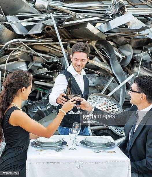 Waiter Toasting with Customer in Landfill