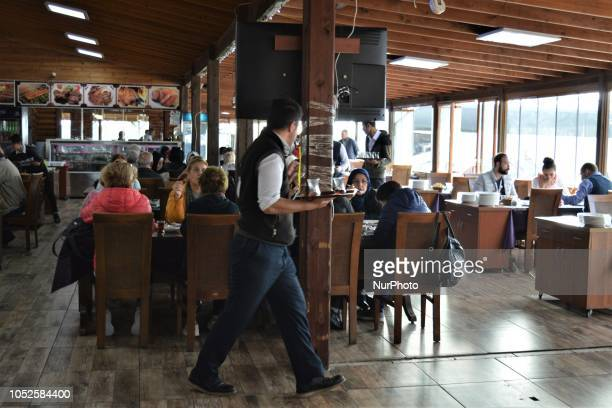 A waiter walks around tables at a roadside restaurant in Bolu Turkey on October 20 2018 Bolu is located along a travel route between Turkey's two...