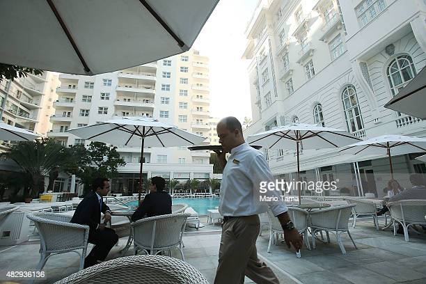 A waiter walks at the upscale Copacabana Palace hotel overlooking Copacabana beach which will be a venue site for various Olympic events ahead of the...