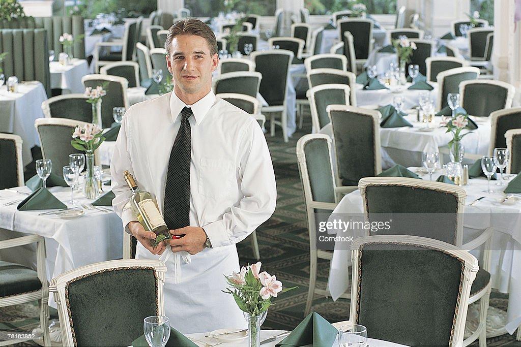 Waiter with bottle of wine : Stock Photo