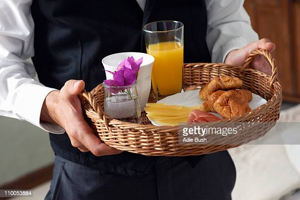 Waiter with breakfast tray