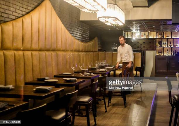 Waiters and bartenders clean up bars and restaurants along North High Street in the Short North District on March 15 2020 in Columbus Ohio Ohio...