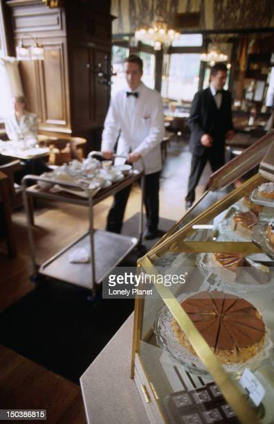 Waiters and cake selection at Cafe Schwarzenberg, Innere Stadt.