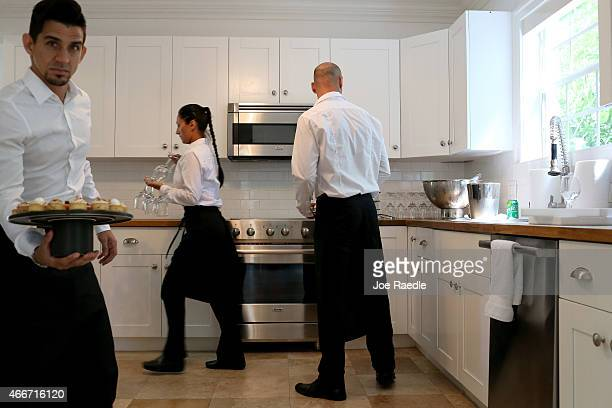 Waiters are seen in the kitchen of the former home of Al Capone during a tour of the historic house on March 18 2015 in Miami Beach Florida The home...