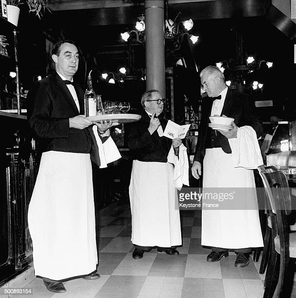 Waiters at the famous Brasserie Lipp in the SaintGermaindesPrés neighbourhood in October 1963 in Paris France