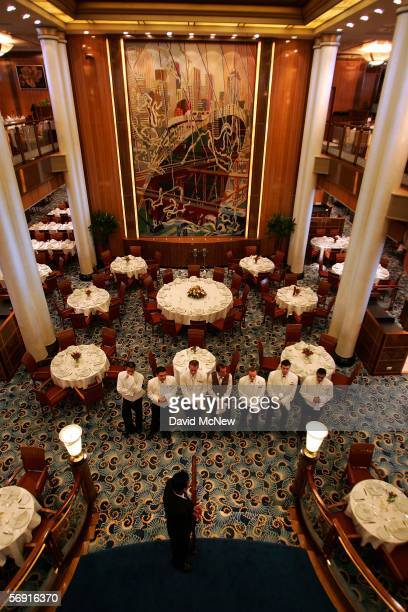 Waiters gather in the Britannia Restaurant aboard the Queen Mary 2 Commodore Warwick cruise ship on its maiden call to the Port of Los Angeles...
