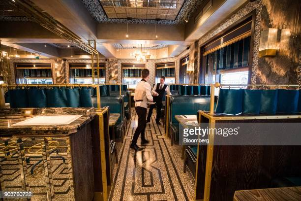 Waiters lay tables ready for lunch in the Bob Bob Ricard restaurant in Soho central London UK on Wednesday Jan 10 2018 Bob Bob Ricard known for a...