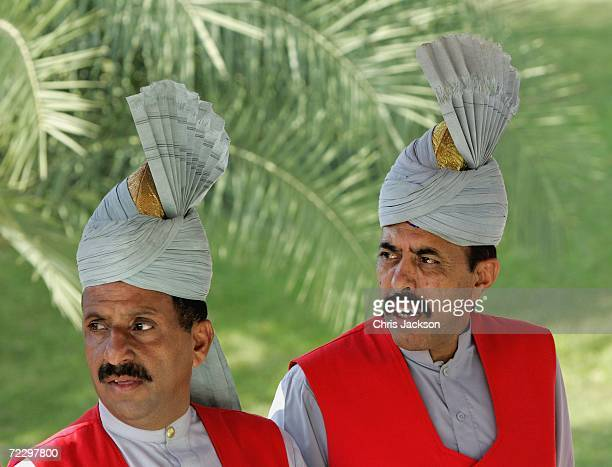 Waiters look on at the Prime Minister's House on day two of a week long Royal tour of the country on October 30 2006 in Islamabad Pakistan