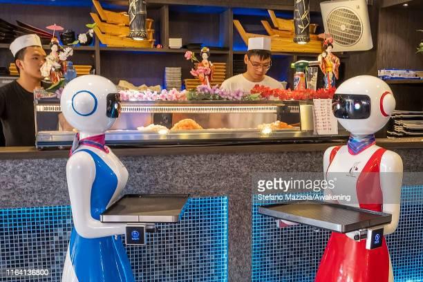 Waiters robots wait near the kitchen on July 25 2019 in Rapallo Italy The Gran Caffè Rapallo restaurant in Liguria is the first restaurant in Italy...