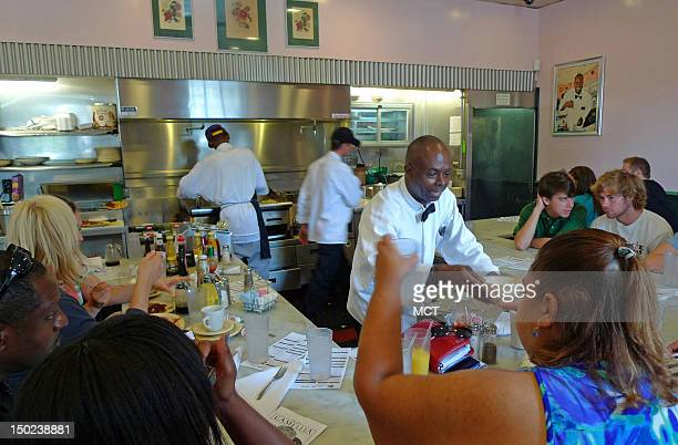 Waiters serve customers at The Camilla Grill in New Orleans Louisiana