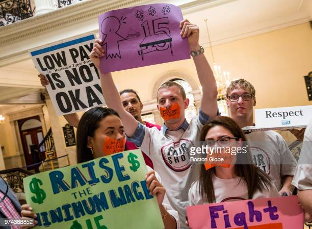Waiters waitresses and other hospitality workers that rely on tips for income take part in a rally at the Massachusetts State House in Boston to...