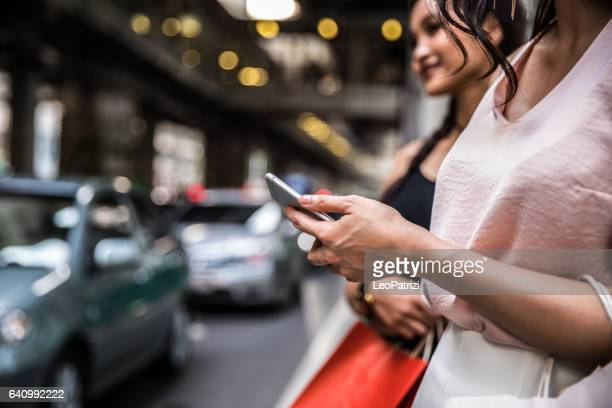 waiting and looking for a taxi ride - car pooling stock photos and pictures