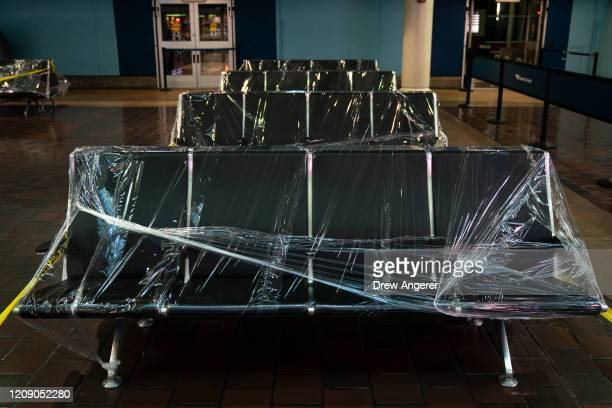 Waiting area chairs are covered in plastic wrap at Union Station on April 3, 2020 in Washington, DC. Earlier this week, the White House said they...