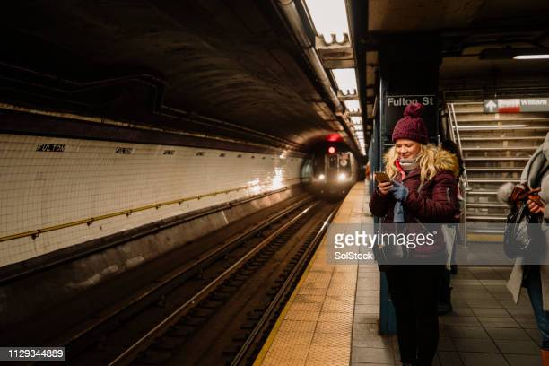 waiting at the subway - subway platform stock pictures, royalty-free photos & images