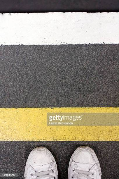 waiting at the tube - double yellow line stock photos and pictures