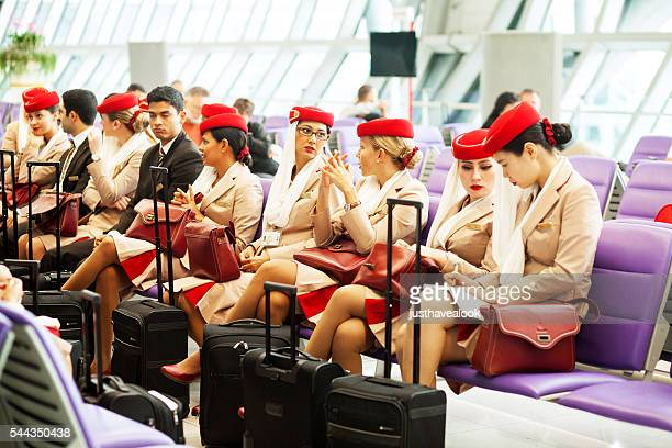 waiting cabin crew of emirates airlines - emirates airline stock photos and pictures