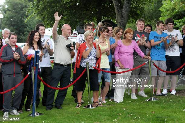 Waiting crowds cheer as Colin and Chris Weir from Largs in Ayrshire celebrate during a photo call at the Macdonald Inchyra Hotel Spa in Falkirk after...