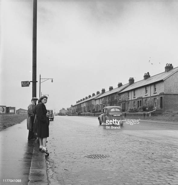 Waiting for a bus on a street near Swansea in South Wales 1943 Original Publication Picture Post story 1448 The Story of the Swansea Valley pub 1st...