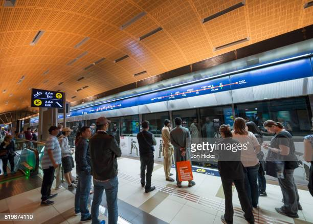 waiting for a train on the dubai metro. - underground station stock pictures, royalty-free photos & images