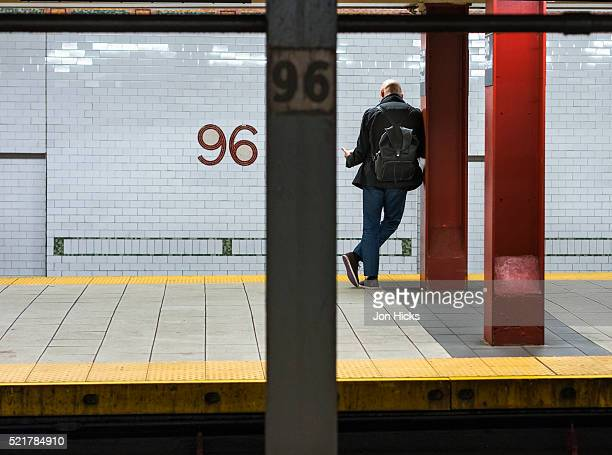 Waiting for a train on the New York City Subway.